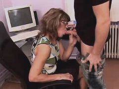 Mature does hot blowjob in office
