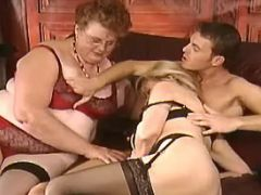 Fat old vixen in stockings has fun in wild orgy