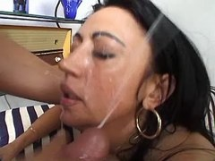 Oversexed brunette sucks two cocks and gets facial