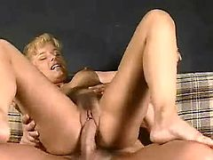 Sexy mature blonde jumping on hard cock on sofa