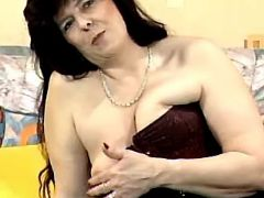 Lewd granny in corset plays with her old pussy