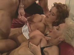 Guy fucking two matures and jizzing