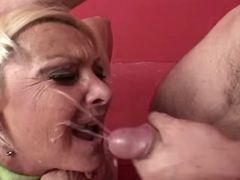 Lusty granny gets lavish cumload on face from guys