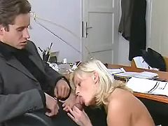 Mature secretary in stockings throats hard cock