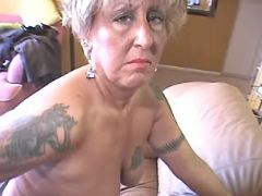 Depraved granny in stockings enjoys big sextoys