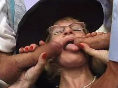 Granny throats two appetizing cocks in groupsex