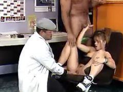 Young redhead office slutty serves men on chair