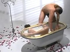 Unfeeling man plunges beautiful nymph in milk bath