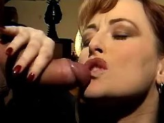Mature redhead secretary gets cumshot on lips
