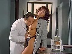 Horny brunette beauty in oral fun with her doctor