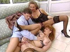 Two alluring mature ladies fuck young dude on sofa