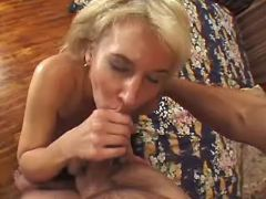 Old madam greedily sucks hard cock of horny guy