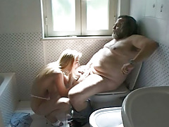 Dirty Kelly having pleasure sucking a large and old man's rod