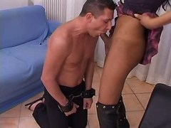 Beautiful tranny in jackboots sucked by slave chap
